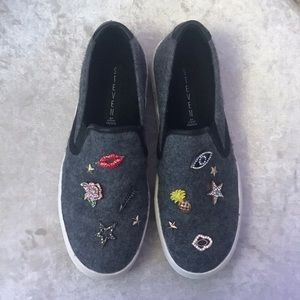 Steve Madden slip ons with assorted jewels.